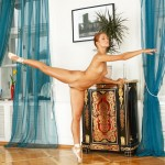 Nude ballerina in pointes stretches her super long legs