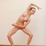 Flexible nude ballerina shows body in nude ballet show