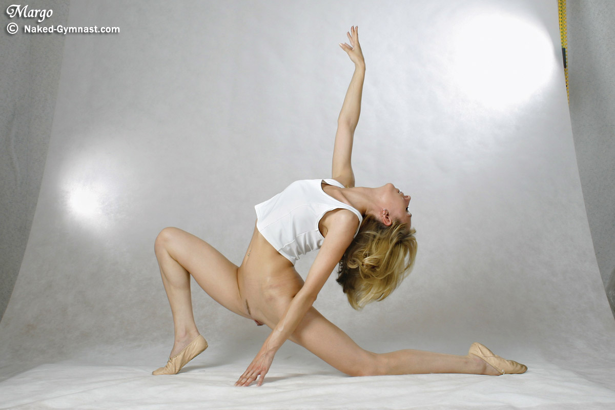 Naked Gymnast Doing Her Stretching Workout