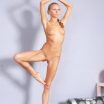 Flexible girl does hot nude yoga exercises in the gym