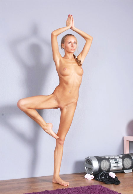Flexible girl does hot nude yoga exercises