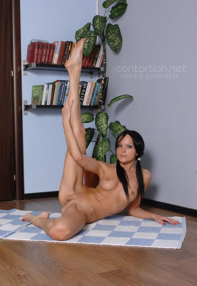 Naked gymnast posing