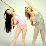 Spandex models expose their delights and caress each other