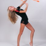 Nude gymnast with long blonde hair undresses and poses