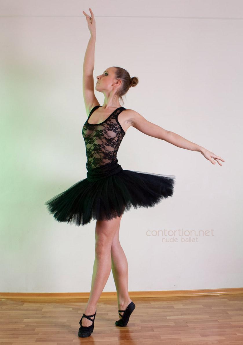 Nude ballerina does ballet exercises