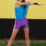Sexy yoga girl in spandex shorts